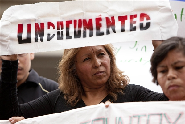 "Maria Cruz Ramirez, one of several undocumented immigrants traveling across the country on the ""undocubus,"" protests during a briefing on the civil rights effects of state immigrations law held by the U.S. Commission on Civil Rights in Birmingham, Ala., on August 17, 2012."